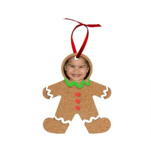 Gingerbread man ornament with face and red ribbon on white background
