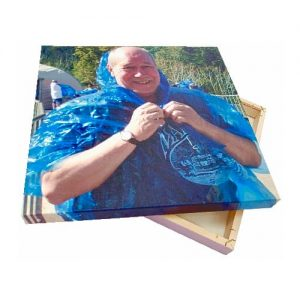 Canvas print of man in blue cape