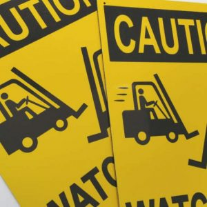 Yellow safety sign showing caution watch for forklift truck
