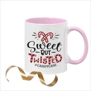 White ceramic 11oz mug with picture of candy canes and wording 'Sweet but Twisted #candycane' with pink inner and pink handle